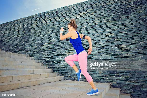 Girl is runing on the city stairs