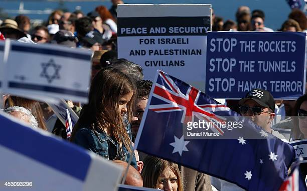 A girl is seen amid flags during a ProIsraeli rally at Dudley Page Reserve on August 3 2014 in Sydney Australia ProIsraeli supporters gathered to to...