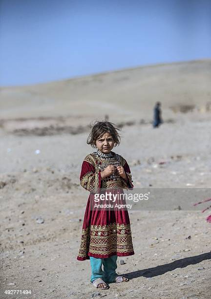 A girl is seen as 85 Afghan internally displaced families live at a camp on the outskirts of Herat Afghanistan on October 15 2015 after their family...
