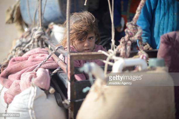 A girl is seen as civilians who were forced to migrate after PYD/ PKK terrorist organizations seized their identification cards and official...