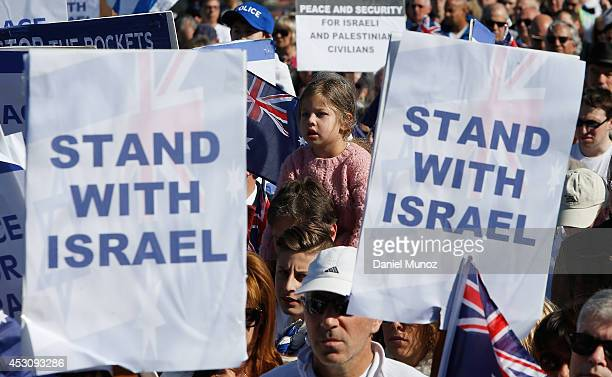 A girl is seen between two placards during a ProIsraeli rally at Dudley Page Reserve on August 3 2014 in Sydney Australia ProIsraeli supporters...