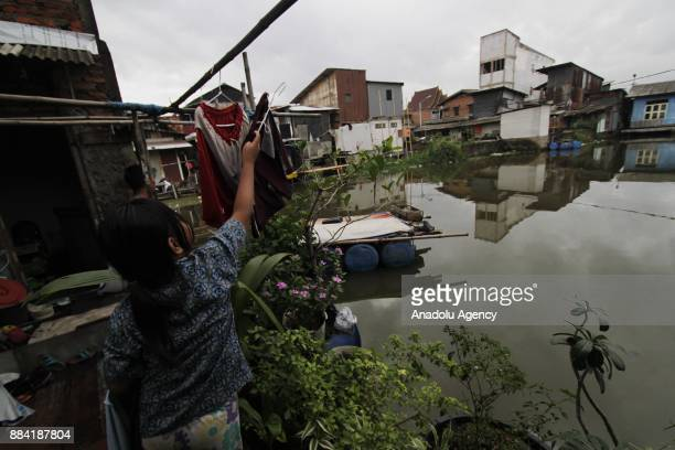 A girl is seen drying clothes at Kapuk Teko village Cengkareng regency of West Jakarta Indonesia on November 30 2017 The village is known as Kampung...