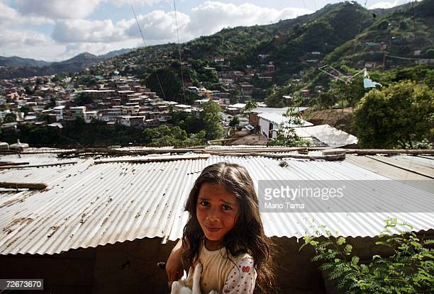 A girl is seen in the poor barrio of Coche November 29 2006 in Caracas Venezuela Despite daily problems with fresh water and electricity residents of...