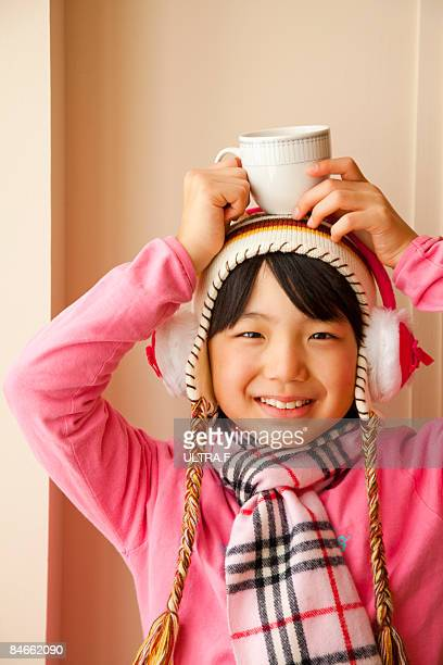 a girl is smiling. - japanese girls hot stock photos and pictures