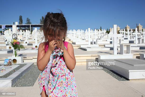 Girl is standing in Timbou cemetery in Nicosia, for the memorial day of people who died in the Turkish invasion in 1974. Cyprus marks 41 years since...