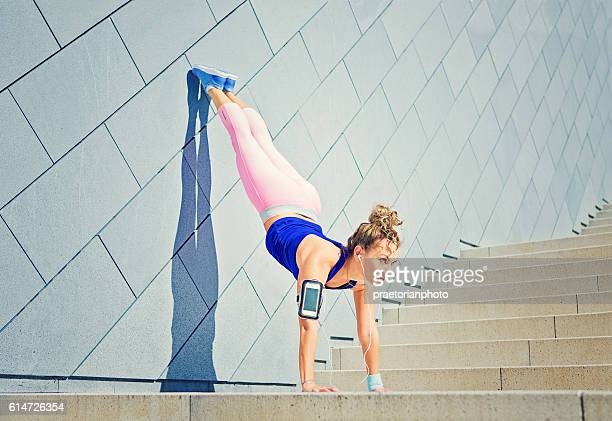 girl is stretching on the city stairs - human limb stock pictures, royalty-free photos & images