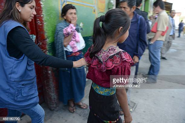 A girl is taken away by an Attorney General's office staffer after having been rescued from a house where she was held captive by a network of human...