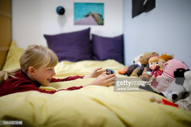 A girl is taking a picture of her dolls with a smartphone on August 14 2018 in Berlin Germany
