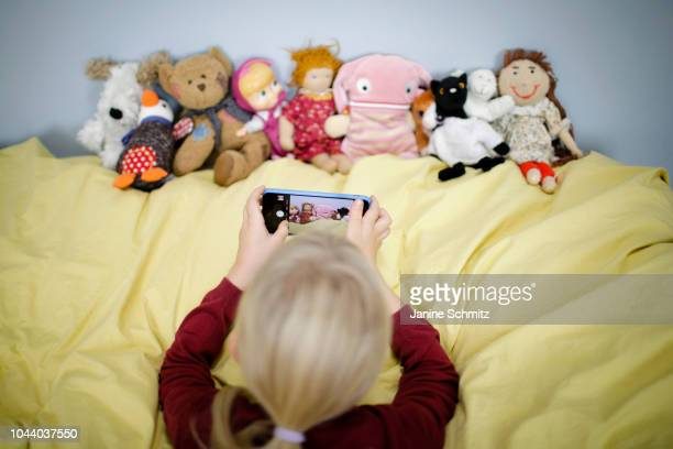 A girl is taking a picture of her puppets with a smartphone on August 14 2018 in Berlin Germany