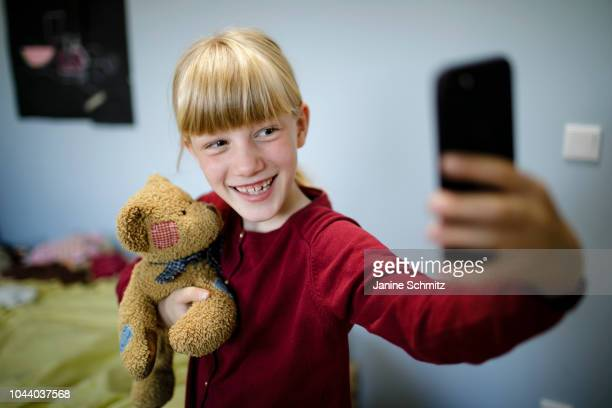 A girl is taking a Selfie of herself and her teddy bear on August 14 2018 in Berlin Germany
