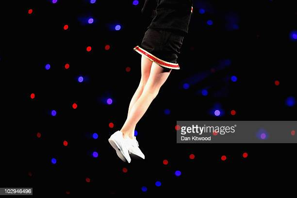 Girl is thrown in the air during a performance at the BCA International Cheerleading and Dance Competition at the Ricoh Arena on July 17 2010 in...