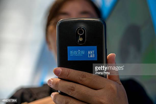 A girl is trying on the new services developed by Ant Financial on a mobile phone In August Alibabas Ant Financial has just launched an integrated...