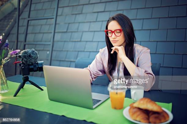 girl is vlogging on the roof terrace in the morning - very young webcam girls stock photos and pictures