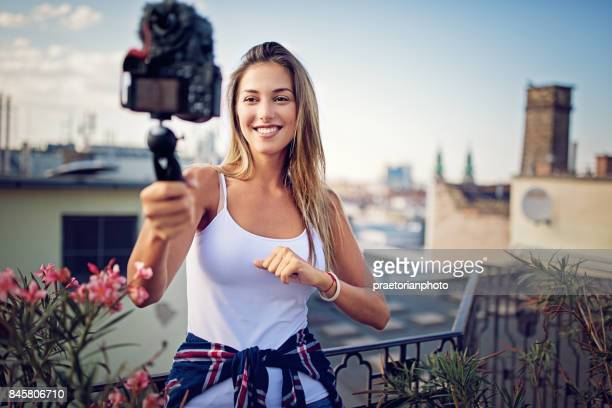 Girl is vlogging on the roof terrace