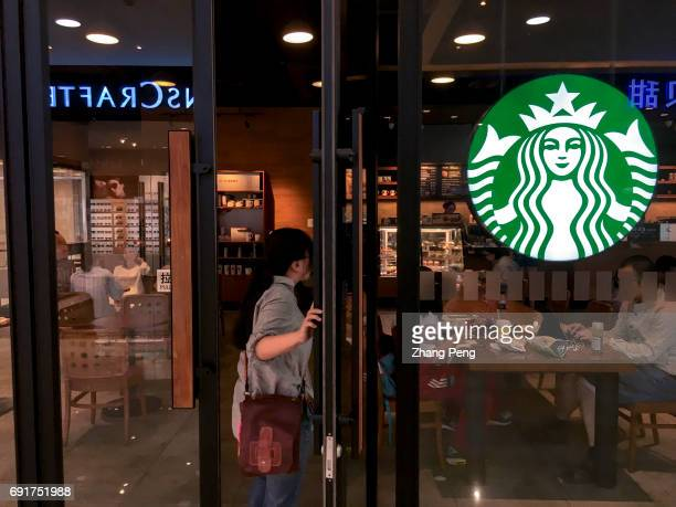 Girl is walking into a Starbucks shop. In the second quarter of 2017, Starbucks opened its stores to five new cities in China. As of now, Starbucks...