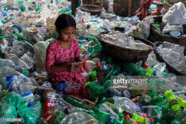 A girl is working in a Plastic recycling factory in Dhaka Bangladesh on March 28 2019