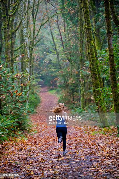 girl jogging in forest - kitsap county washington state stock pictures, royalty-free photos & images