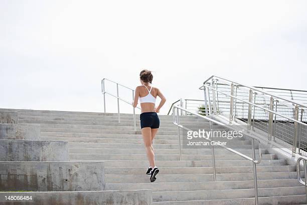 Girl jogging up steps