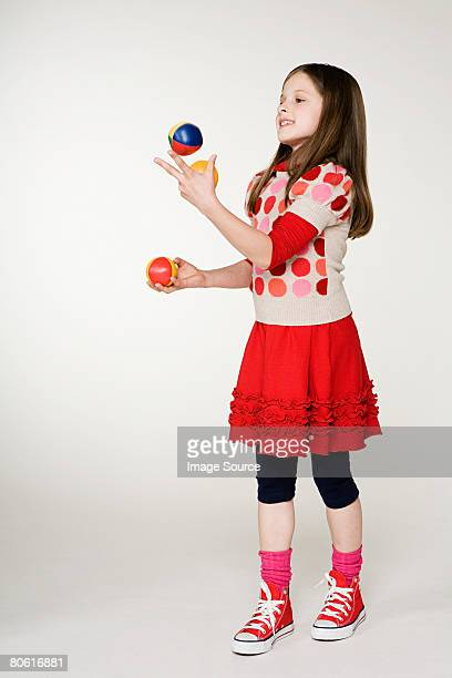 a girl juggling - juggling stock pictures, royalty-free photos & images