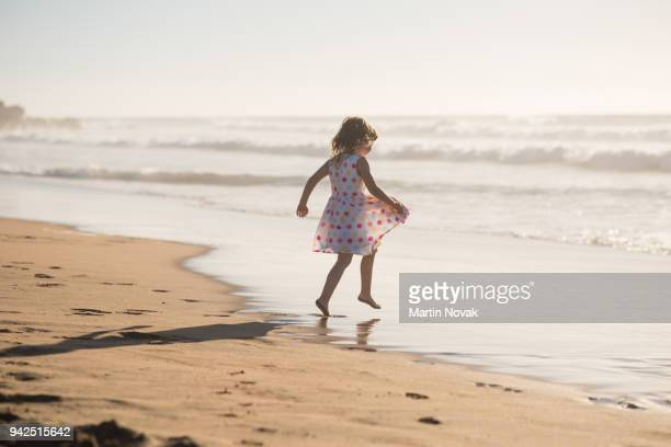 Girl jump into waves