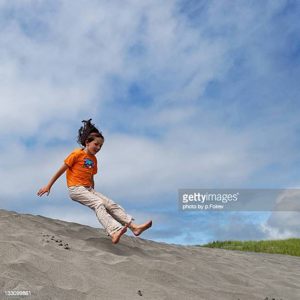 Girl jumping and getting ready for landing