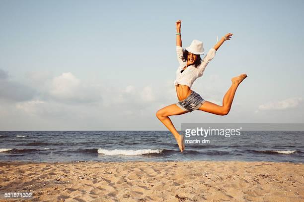 Girl jumping at the beach