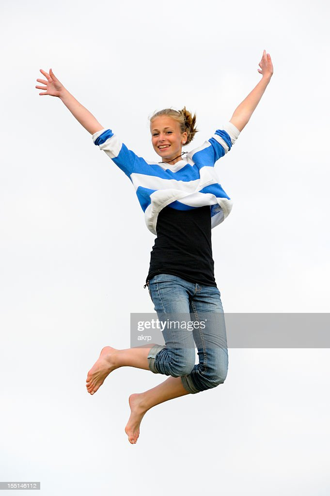 girl jumping for joy stock photo getty images