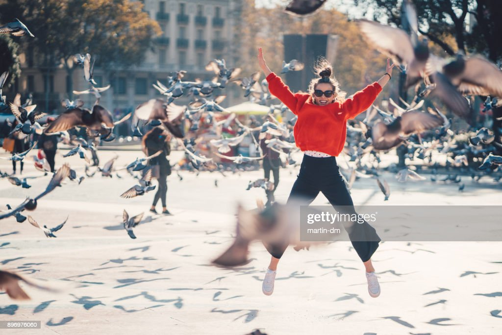 Girl jumping from joy in Barcelona : Stock Photo
