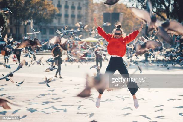 girl jumping from joy in barcelona - allegro foto e immagini stock