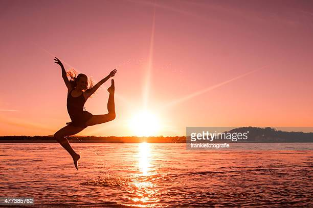 Girl jumping high in the air