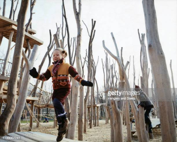 girl jumping in adventure playground - skipping along stock photos and pictures