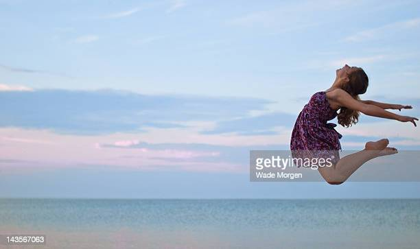 girl jumping in air - morgen stock pictures, royalty-free photos & images