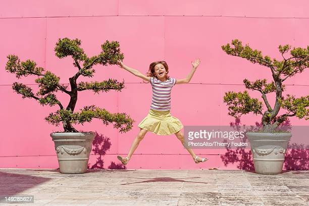 girl jumping in air, portrait - legs spread open stock photos and pictures