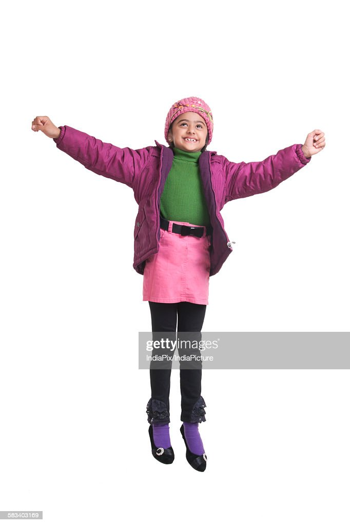 Girl jumping in the air : Stock Photo