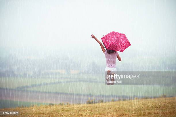 Girl Jumping in the Rain