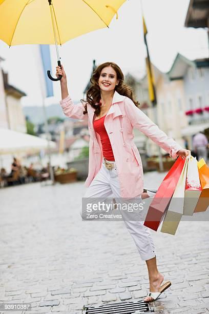 girl jumping in the rain