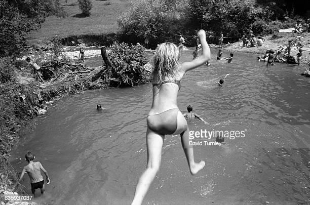 Girl Jumping into a River
