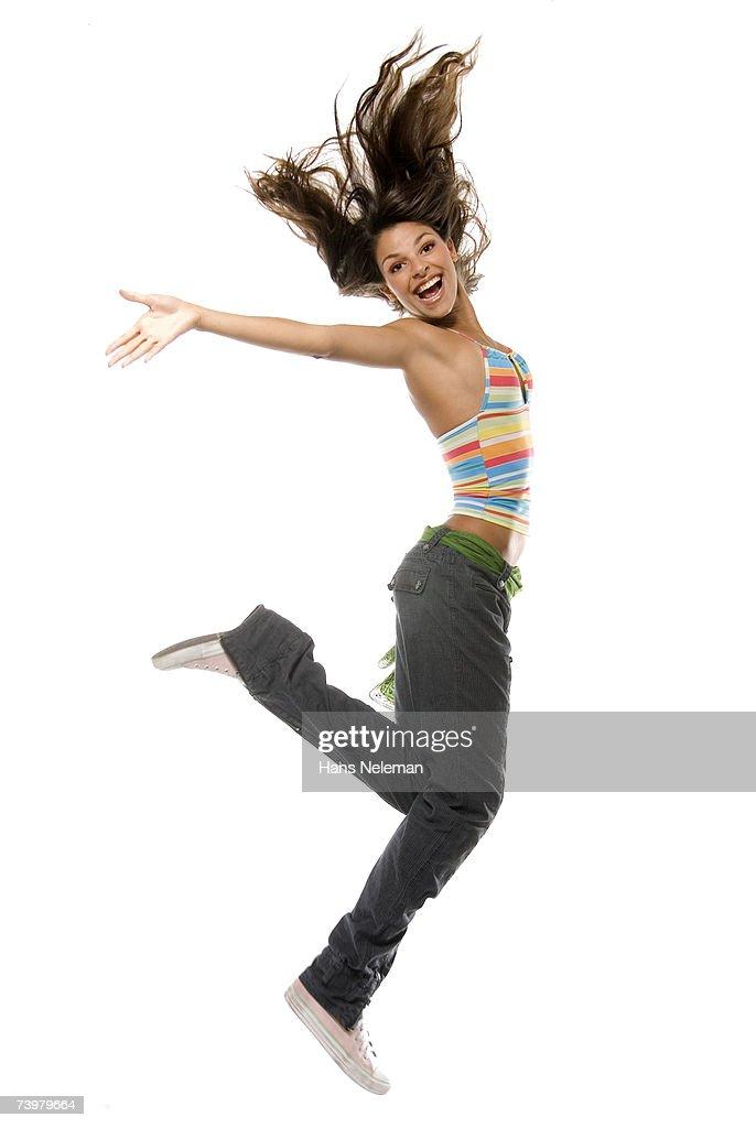 Girl jumping into air : Bildbanksbilder