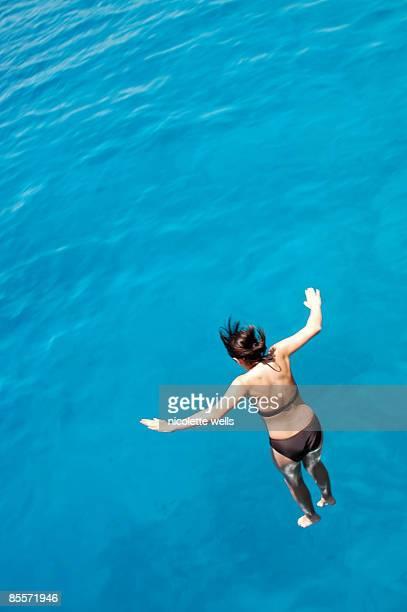 girl jumping into the red sea - シャルムエルシェイク ストックフォトと画像