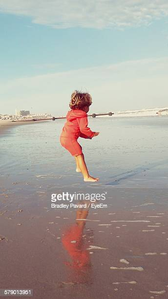 girl jumping on beach - pavard stock pictures, royalty-free photos & images