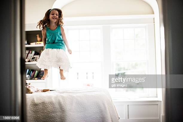 Girl (6yrs) jumping on bed
