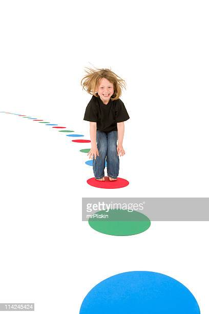 Girl jumping on colourful circles