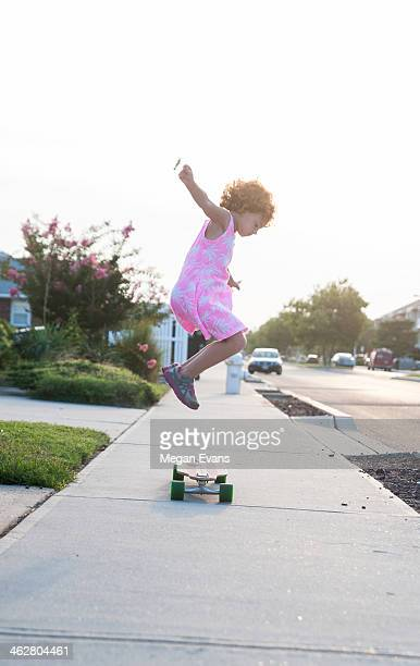 girl jumping on skateboard - tomboy stock photos and pictures