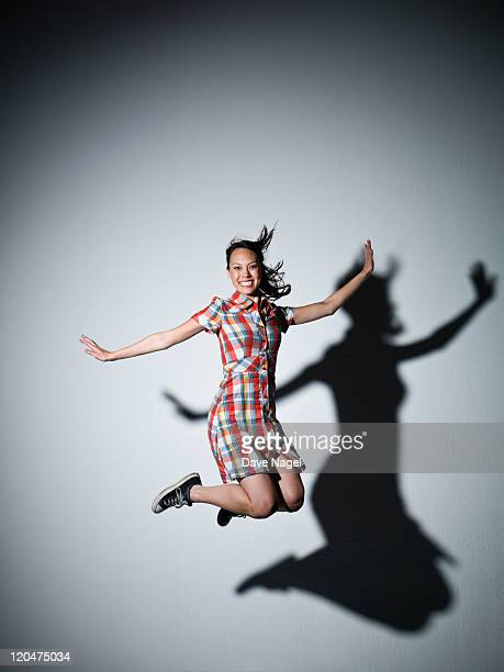 A girl jumping on trampoline