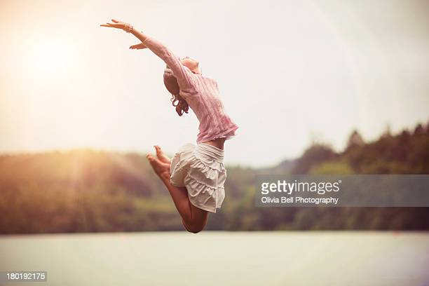 Girl Jumping over Lake