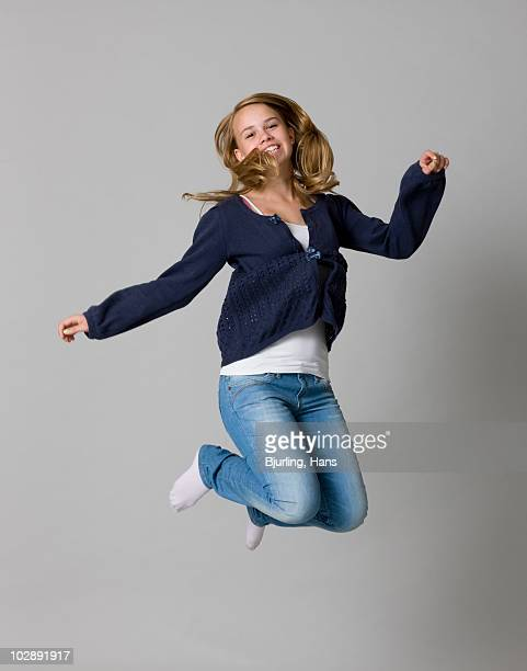girl jumping - girls in socks stock photos and pictures