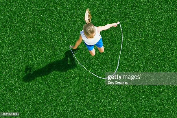 girl jumping rope - jump rope stock pictures, royalty-free photos & images