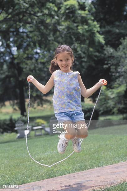 girl jumping rope - skipping along stock-fotos und bilder
