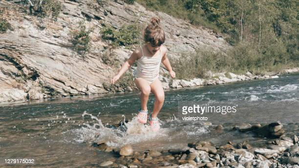 girl jumps in the river - moldova stock pictures, royalty-free photos & images