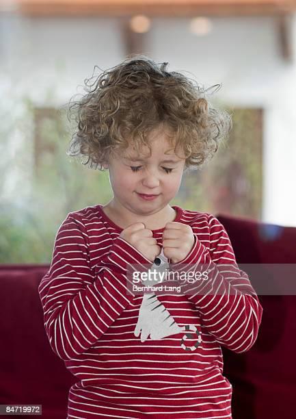Girl (5y) keeping fingers crossed